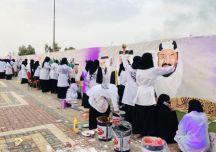 100 فنانة يرسمن أكبر لوحة جدارية خلال احتفالات يوم الوطن 88 بحائل