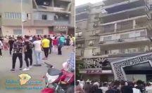 بالفيديو…شخص يرمي أموال من بلكونة شقته ( عيدية ) في مصر على المارة وتدافع للحصول عليها